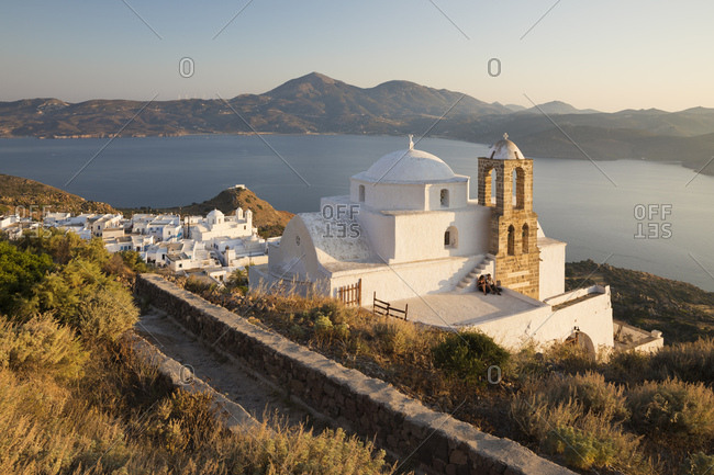 June 24, 2017: View of Plaka with Greek Orthodox church and Milos Bay from Plaka Castle, Milos, Cyclades, Aegean Sea, Greek Islands, Greece, Europe