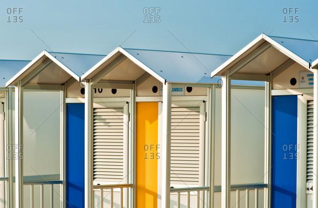 September 23, 2012: Colorful beach huts on the beach of Lignano Sabbiadoro, famous touristic destination in the Adriatic coast, Friuli Venezia Giulia, Italy