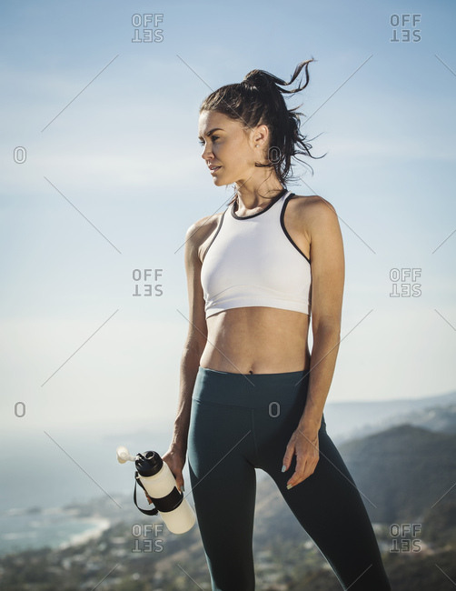 Woman in sportswear with water bottle