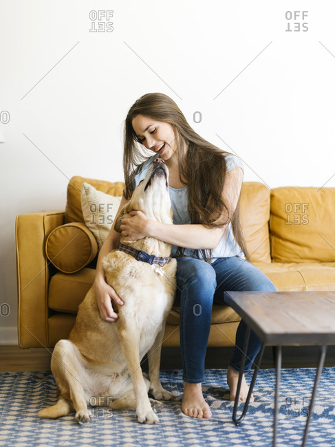 Woman on sofa with dog