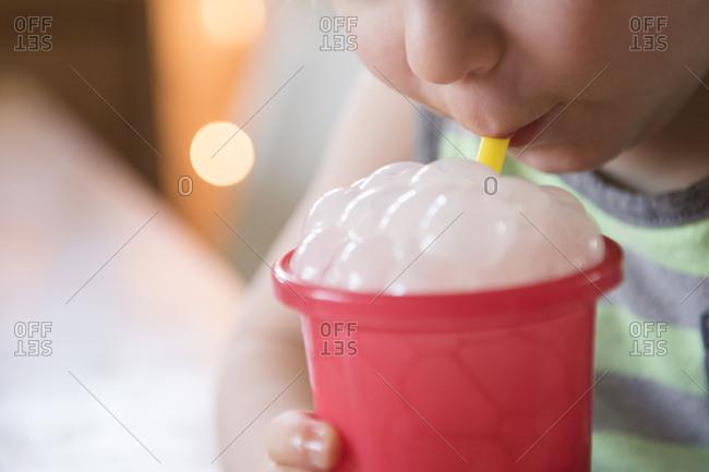 Boy blowing bubbles in drink