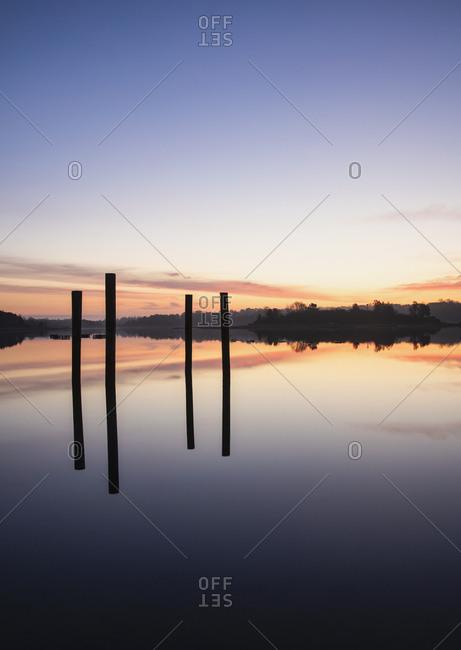 Posts in sea at sunrise