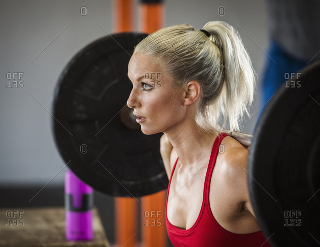 Young woman weight lifting
