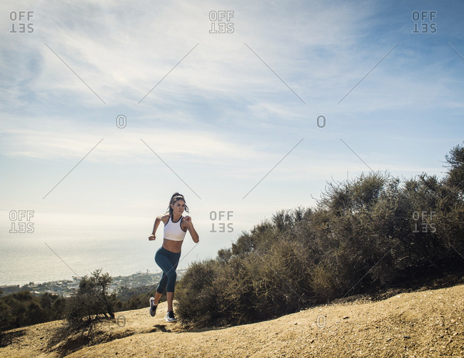 Woman jogging on mountain