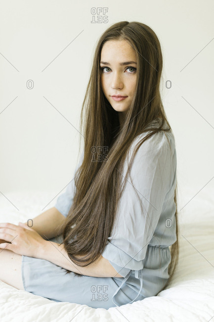 Portrait of young woman with long brown hair