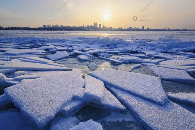 Ice on river at sunset
