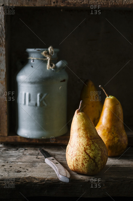 Still life with pears and vintage farmhouse vase in wooden box