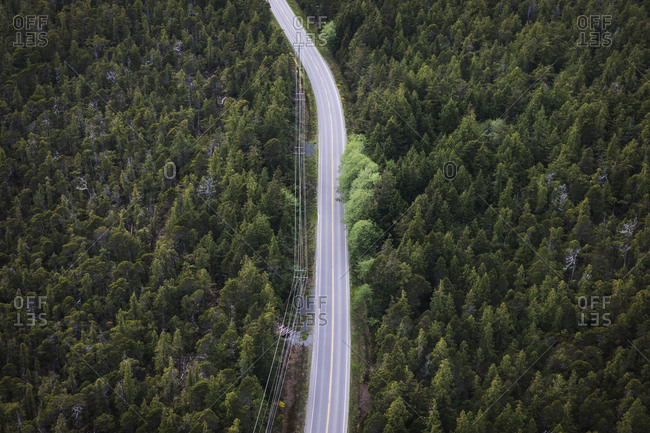 Aerial view of two lane highway through forest