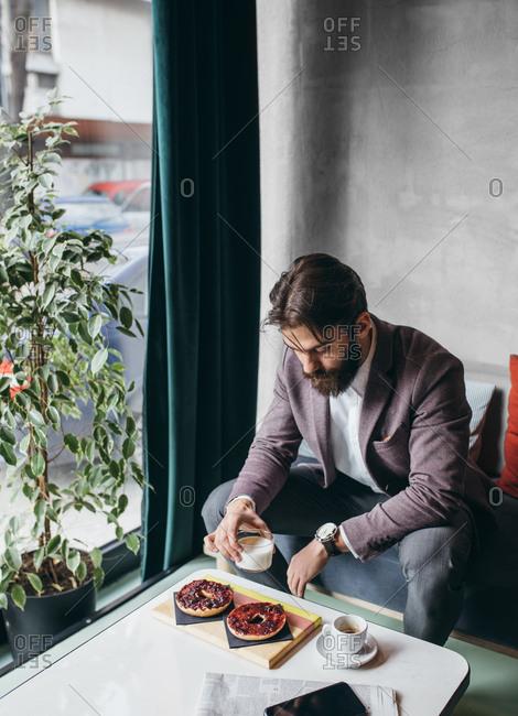 Businessman having breakfast at coffee shop