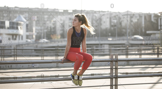 Woman athlete sitting outdoors