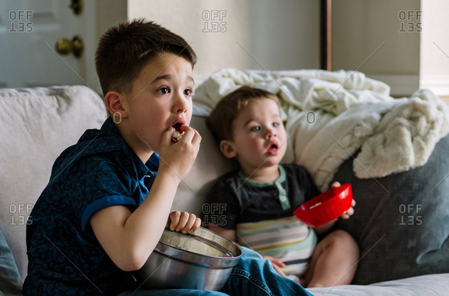 Two boys captivated by a movie