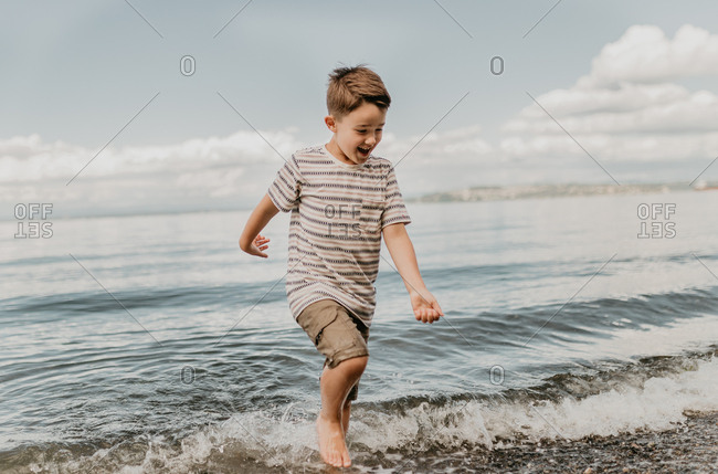 Young boy playing in the waves of the Puget Sound