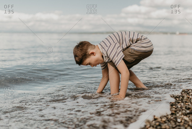 Young boy playing in the ocean