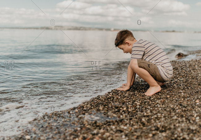Young boy playing in the waves