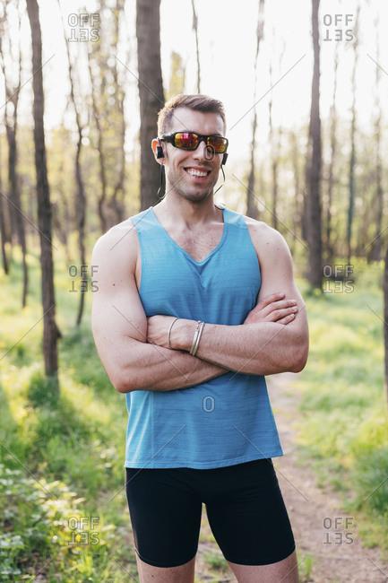 Young muscular man posing outdoors