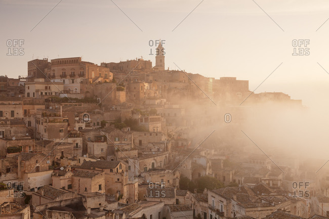 View about the Old Town quarter Sasso Caveoso to the cathedral at sunrise, UNESCO world cultural heritage, Matera, Basilicata, Apulia, Italy