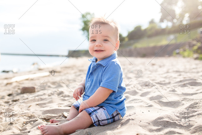 Baby sitting in sand on a beach