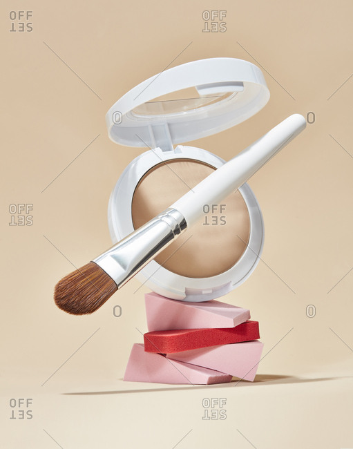 Neutral powder foundation, makeup brush, and beauty wedges