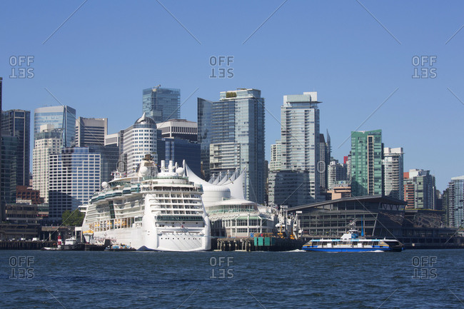Vancouver, British Columbia, Canada - July 13, 2018: Vancouver skyline and cruise ship docked at Canada Place