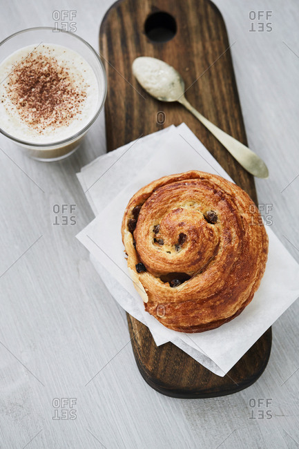 Cappuccino served with pastry