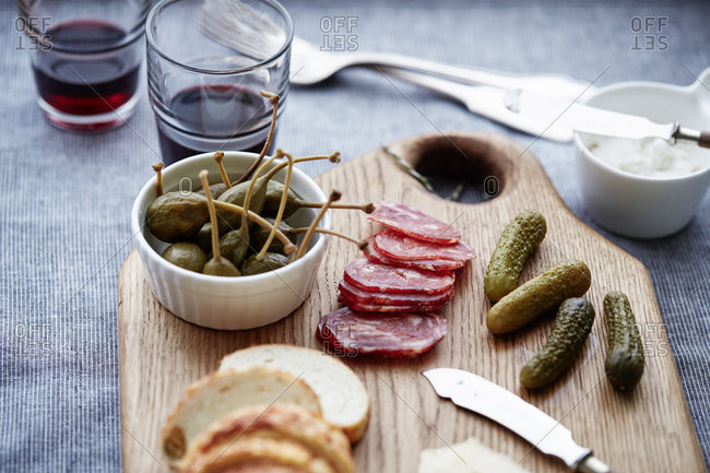 A charcuterie board with bread and olives