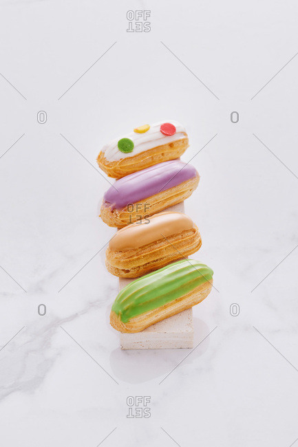 Colorful French eclairs with icing
