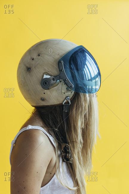Portrait of young woman wearing vintage helmet