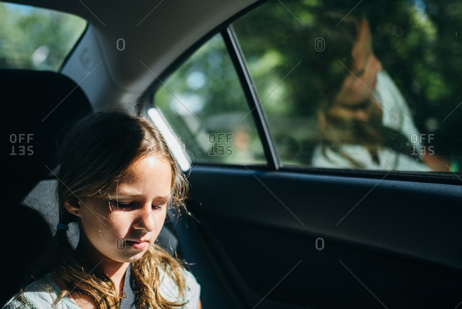 Portrait of a girl sitting in a car