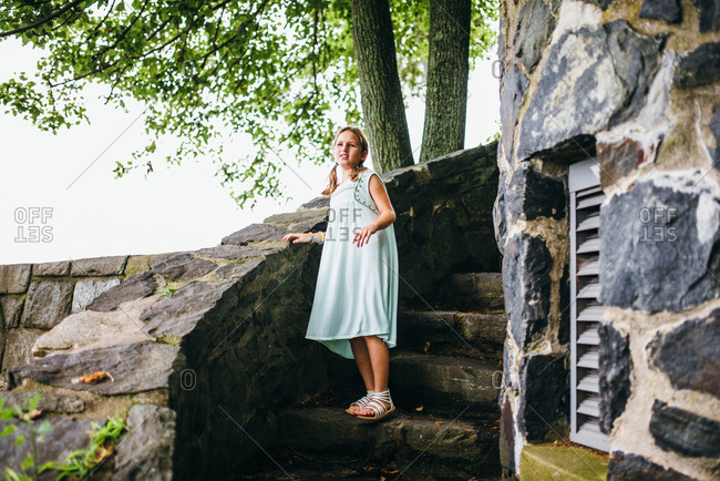 Girl standing on stairs outside of historic castle