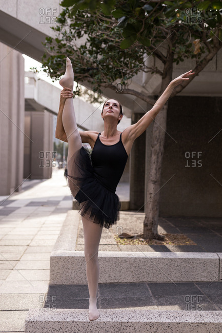 Beautiful woman performing ballet in the city