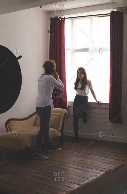 Female model posing for a photo shoot in photo studio