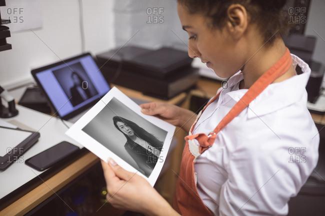 Female photographer developing photos in photo studio