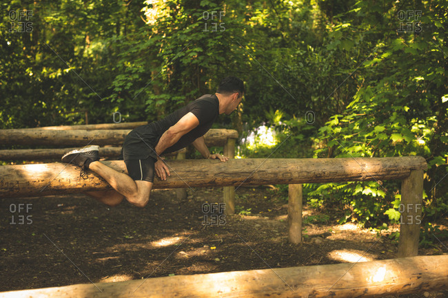 Fit man training on fitness trail at boot camp
