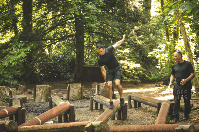 Fit man training over obstacle course at boot camp