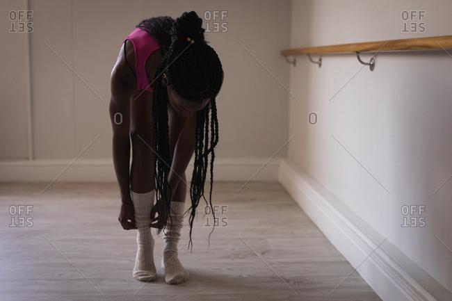 Fit woman wearing socks in fitness studio