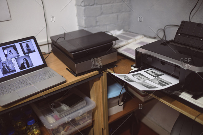 Laptop with photo scanner and printer in photo studio