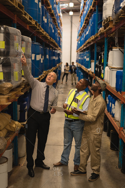 Staff interacting with each other in warehouse