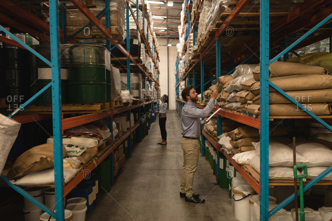 Attentive Staff checking stocks in warehouse