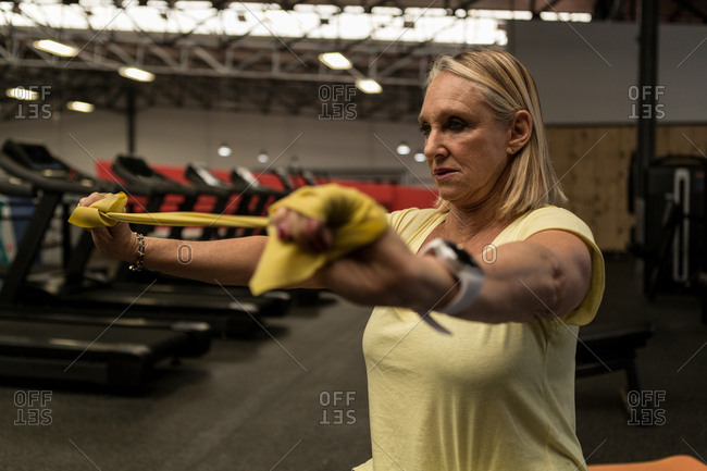 Disabled woman exercising with resistance band in the gym