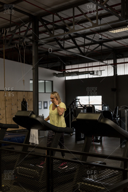 Disabled woman exercising on treadmill in the gym