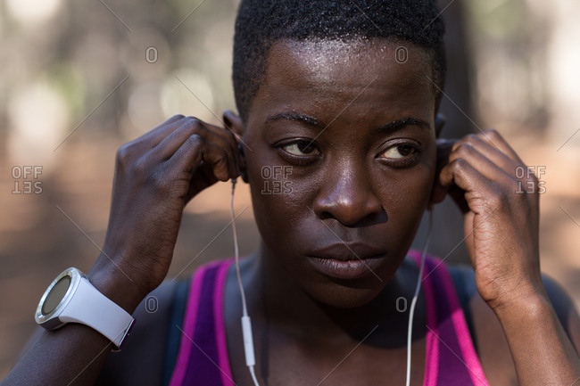 Close-up of female athlete listening to music in headphones