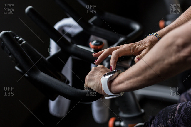 Disabled woman exercising on a gym cycle