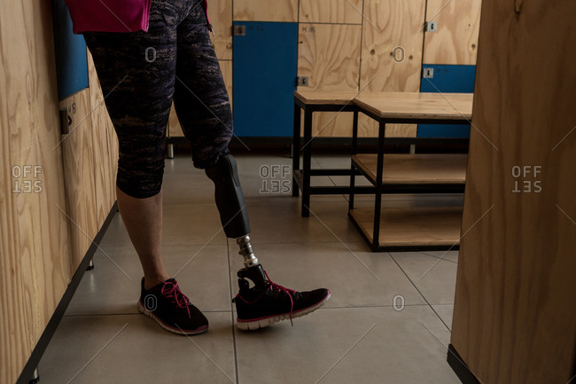 Low section of disabled woman standing in the gym