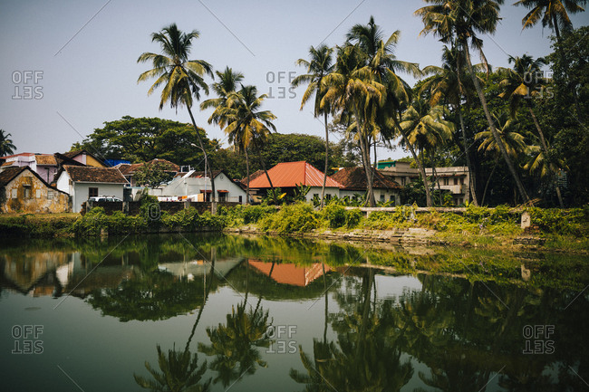 Fort Kochi, India - February 13, 2018: Reflections in a small water pond