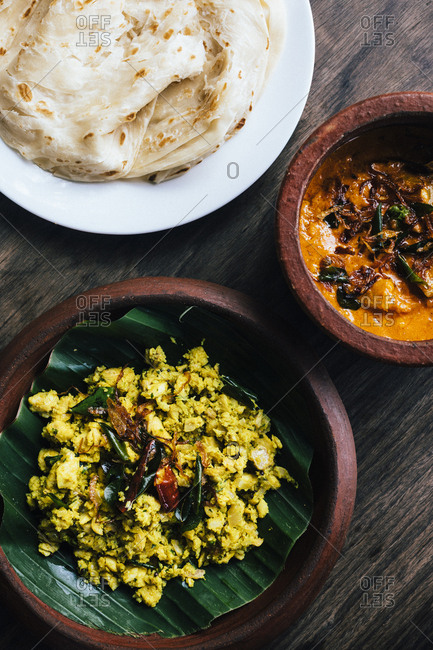 Fort Kochi, India - February 14, 2018: Fish peera and prawn mango curry with roti at the Fort House in Kochi, India