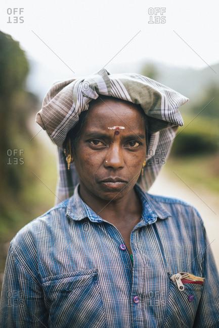 Munnar, India - February 16, 2018: Portrait of a female tea plantation worker