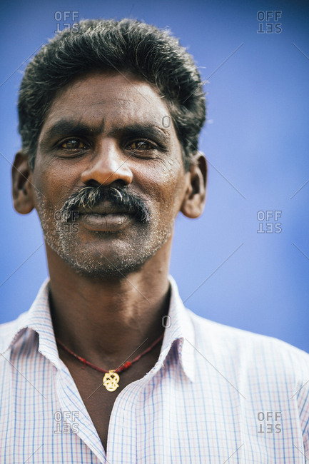 Munnar, India - February 16, 2018: A portrait of a male tea plantation worker