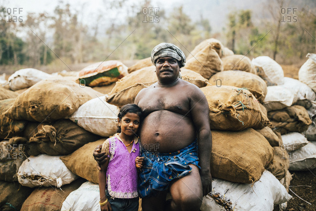 Neriamangalam, India - February 17, 2018: A proud father poses with his daughter at his ginger fields along the Periyar river