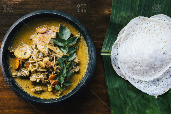 Alleppey, India - February 19, 2018: A traditional duck curry with appam