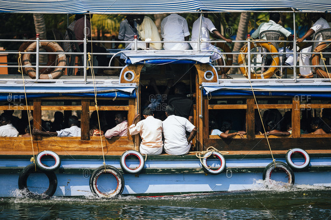 Alleppey, India - February 20, 2018: A crowded transport boat on the Keralan backwaters
